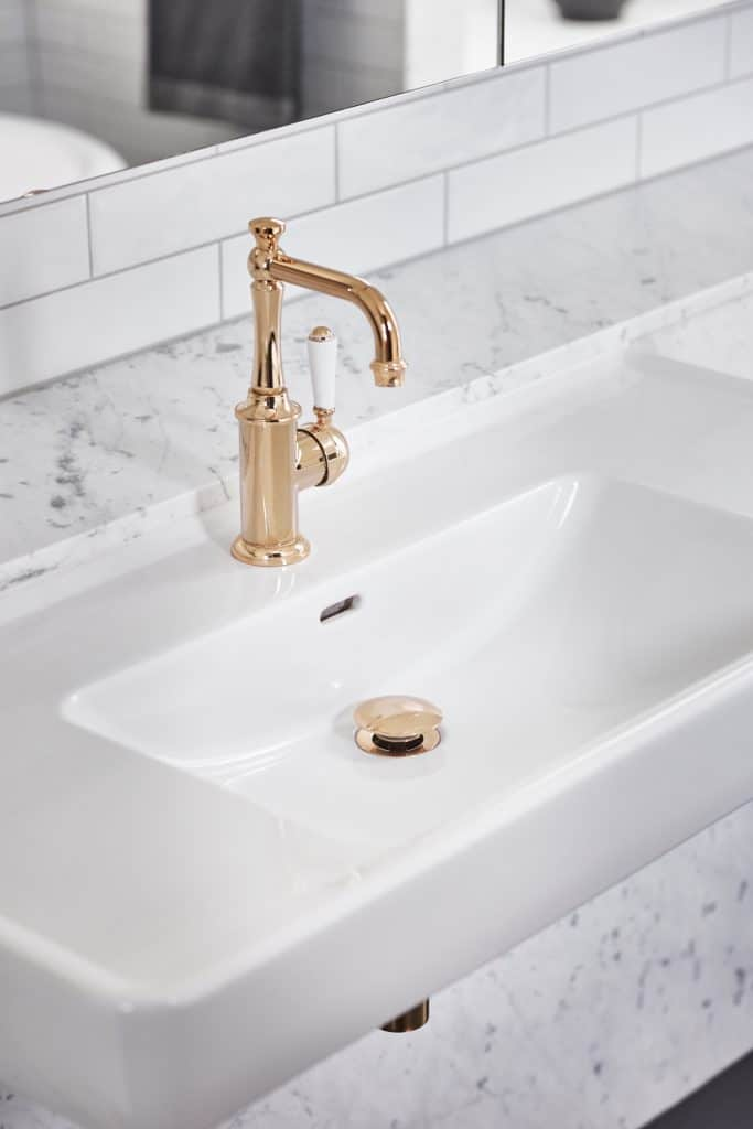 A sink with a faucet  Description automatically generated